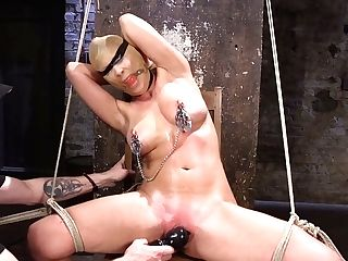 Hog-tied Bitch Cherie Deville Is Fucked With Lengthy Stick And...